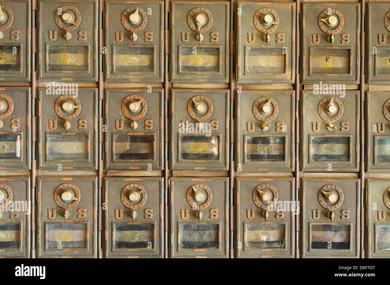 old brass US mail pigeonhole mailboxes with combination locks - Stock Image