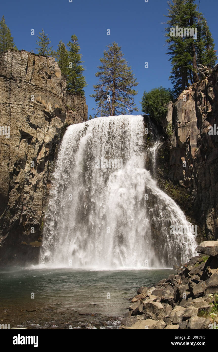 vertical image of Rainbow Falls at Devil's Postpile National Monument from below - Stock Image