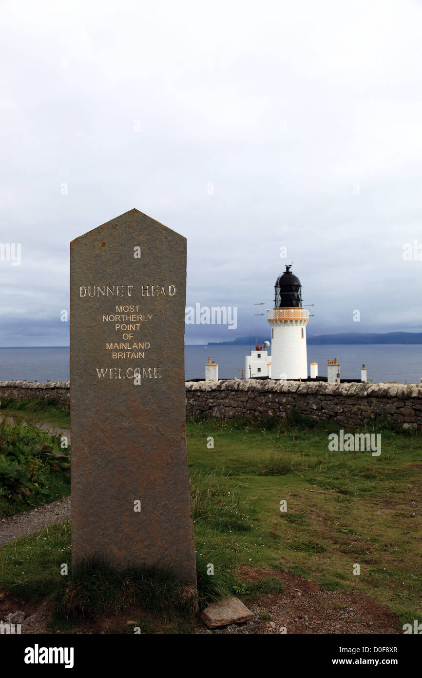 Dunnet Head lighthouse and stone marker, Dunnet ,Scotland UK - Stock Image