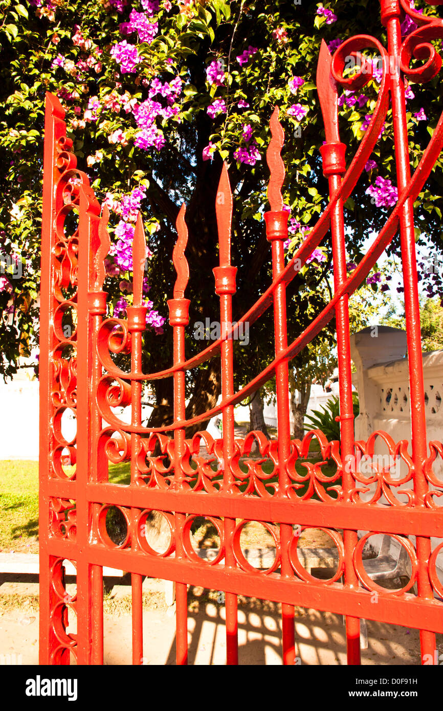Red iron fence located in the house front - Stock Image