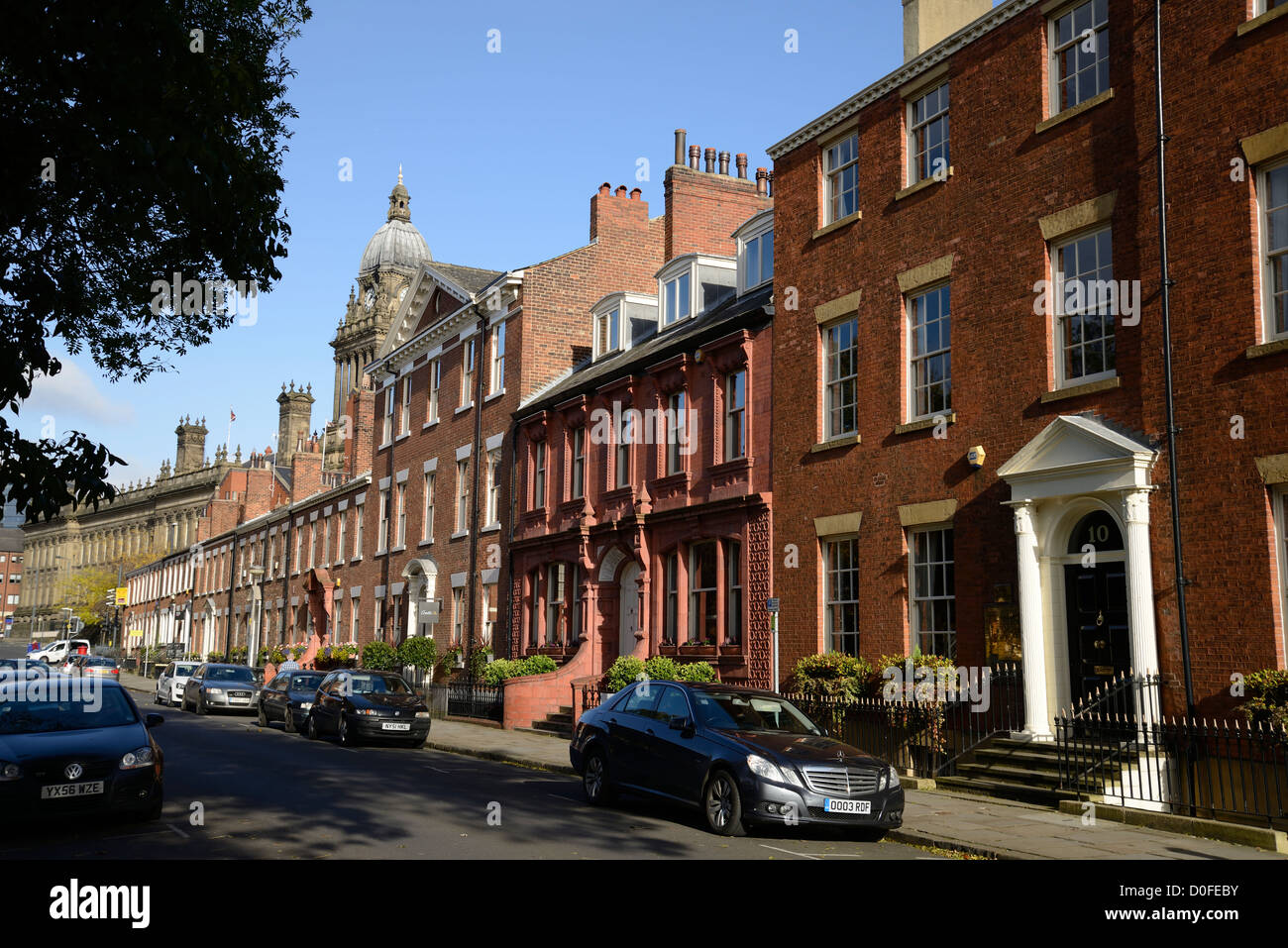 A street in central Leeds showing various types of architecture. Park Square East. - Stock Image
