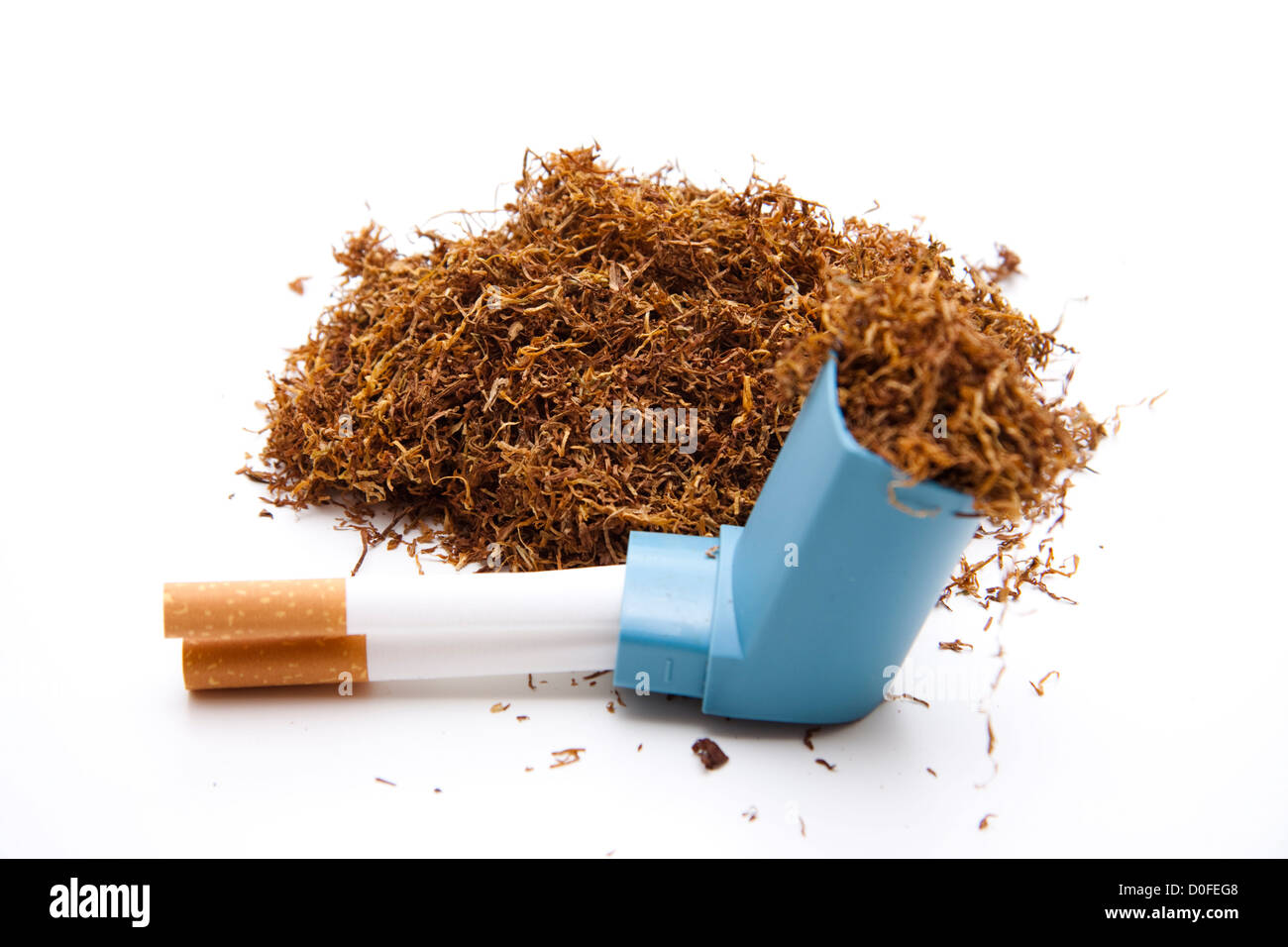 Tobacco with cigarets and Inhaler - Stock Image