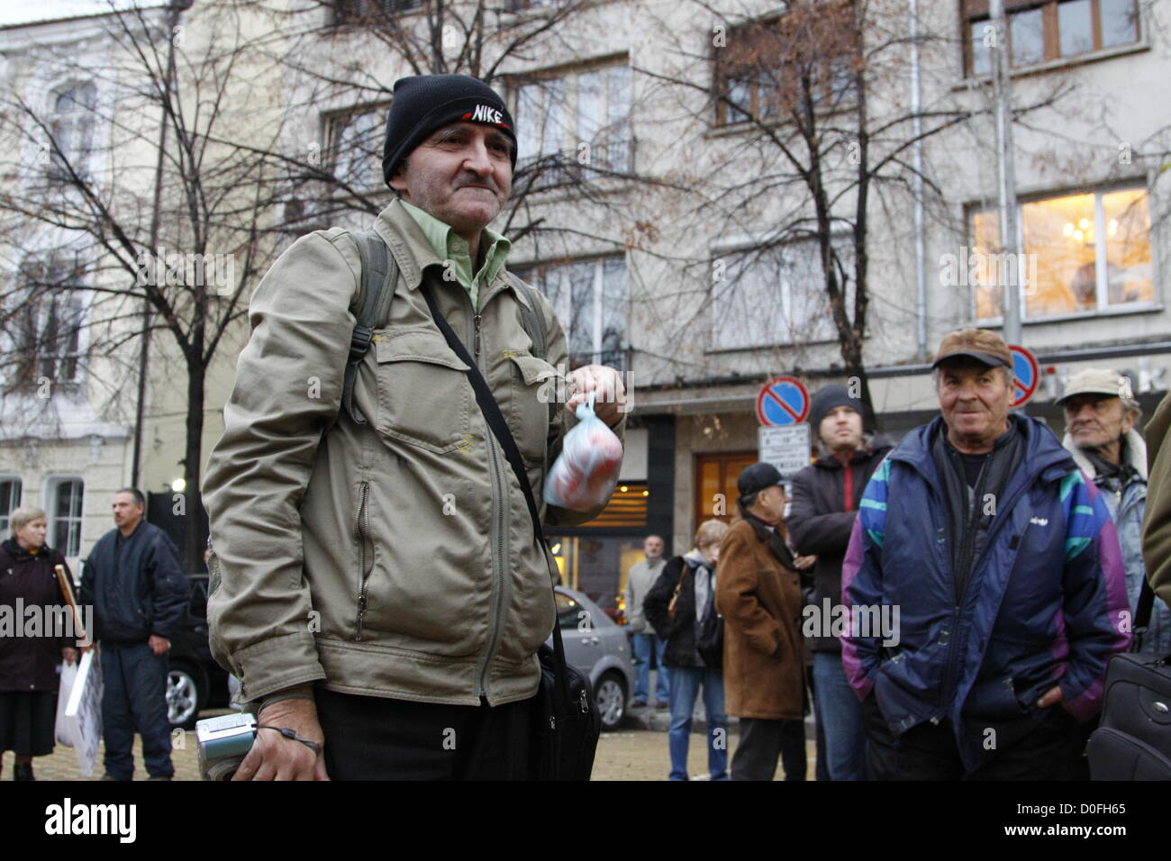 Sofia, Bulgaria; 24th November, 2012. Demonstrator holding a bag with tomatoes as 'ammunition' for the anti - Stock Image