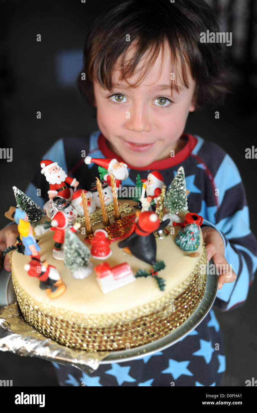 7 Year Old Boy Decorating A Christmas Cake Made By His Grandma