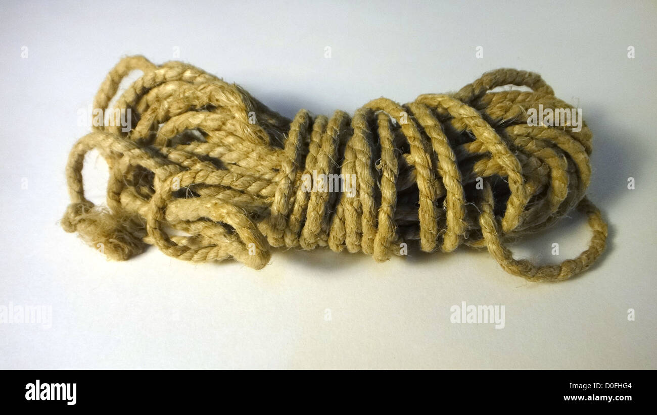 hemp rope,rope, all tied, case closed, ball of string, tether - Stock Image