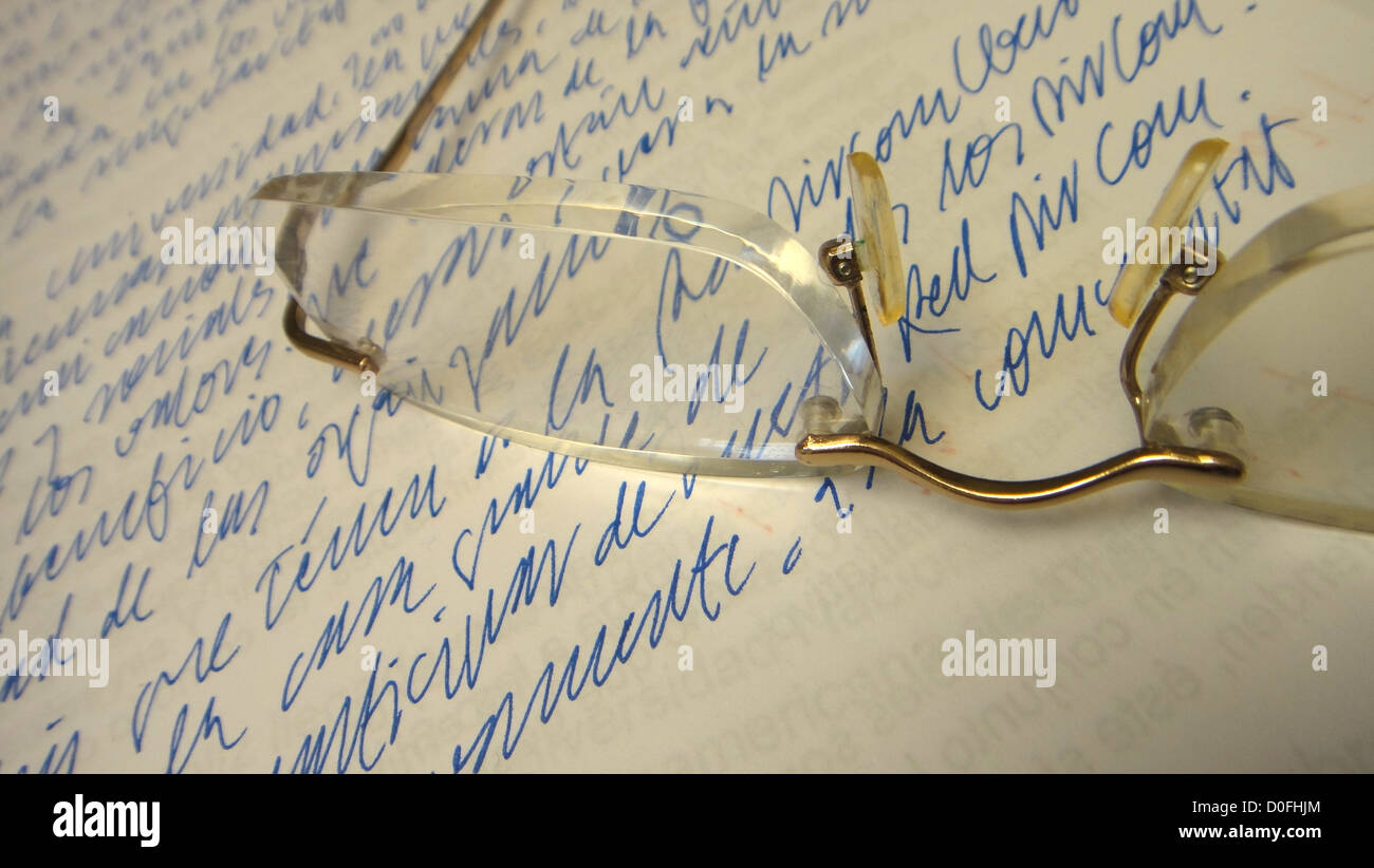 reading glasses on a piece of paper hand written, thinking, pause, break, reflection,meditating, presentation of - Stock Image