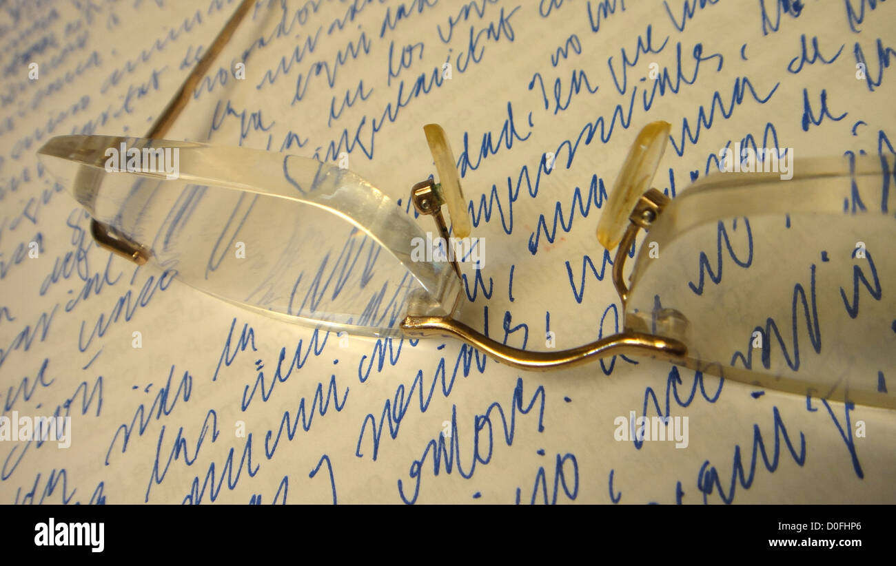 reading glasses on a piece of paper hand written, thinking, pause, break, reflection,meditating, presentation of Stock Photo