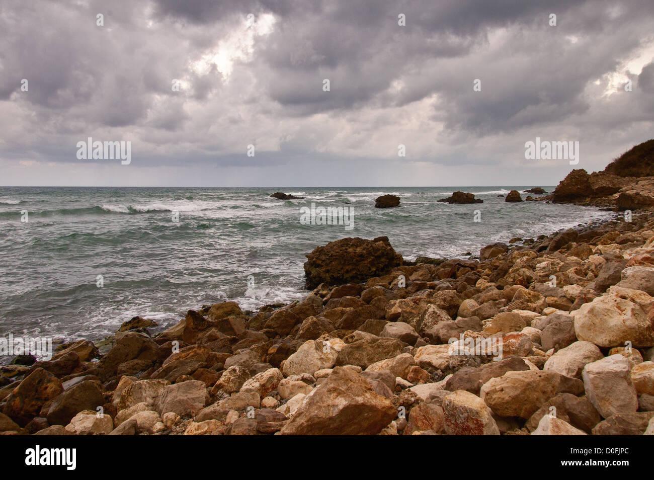 rocky coastline on a rainy day Stock Photo