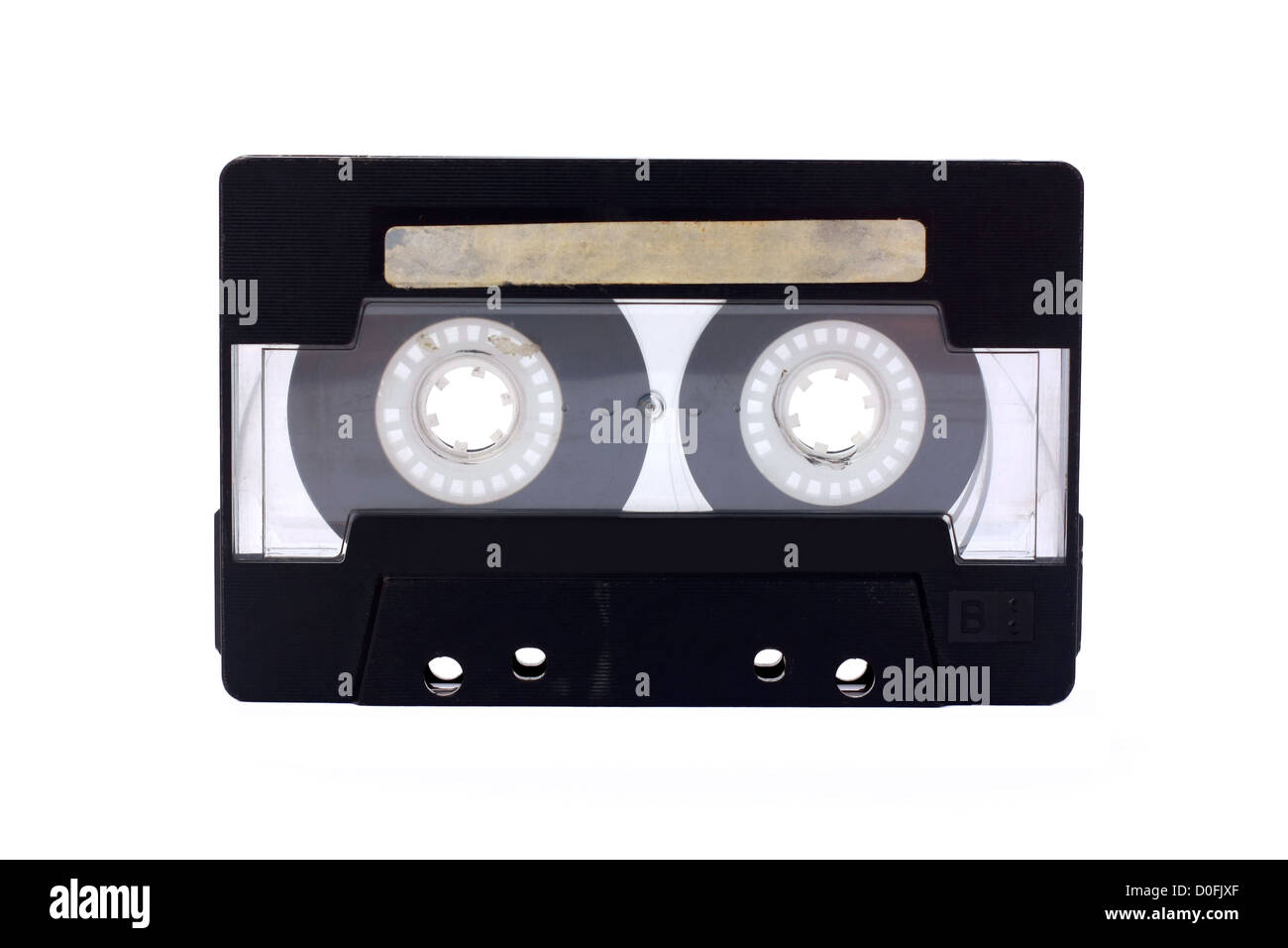 Black-transparent Compact Cassette isolated on white - Stock Image