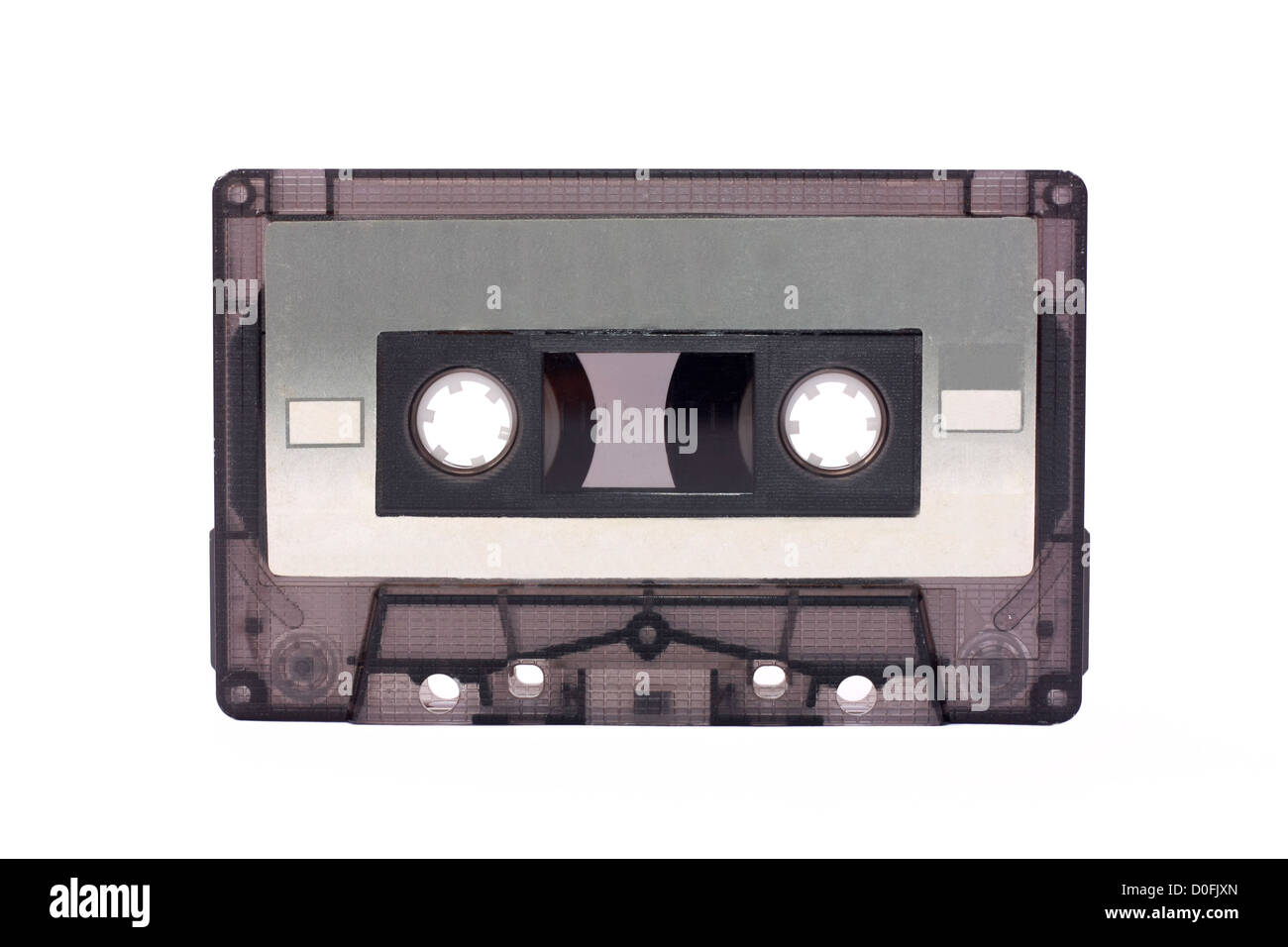 Gray-transparent Compact Cassette isolated on white - Stock Image