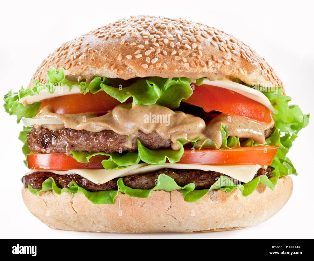 Tasty hamburger on white background. - Stock Image