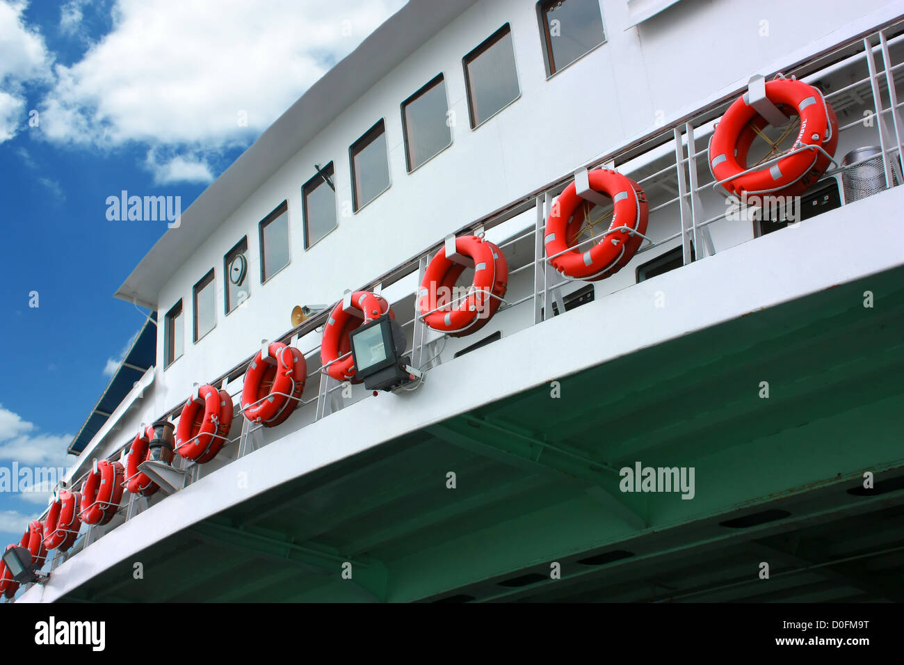 Ordered life rings on ferryboat - Stock Image