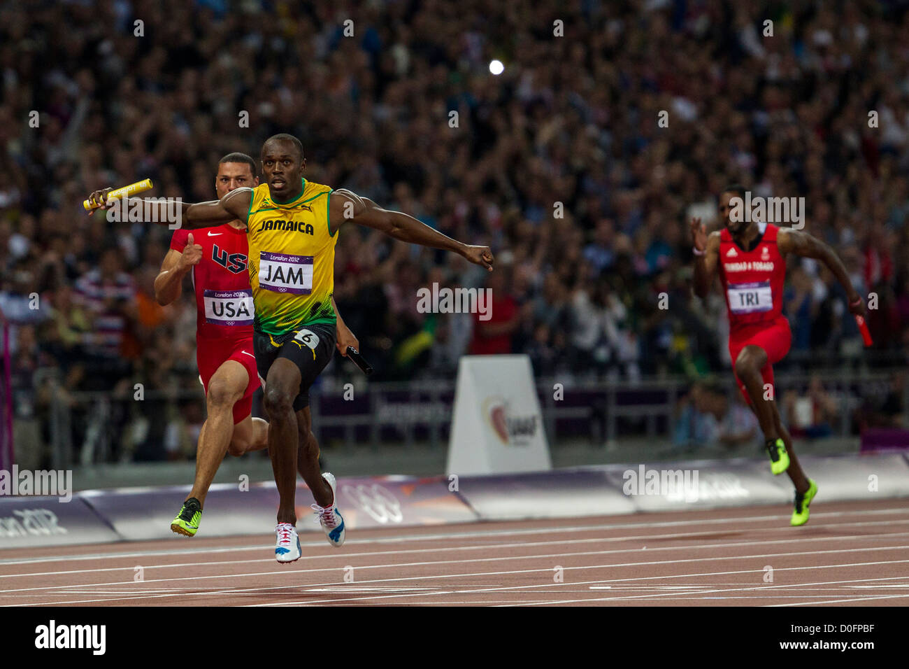Usain Bolt winning the gold medal for Jamaican in the 4X100m relay at the Olympic Summer Games, London 2012 - Stock Image