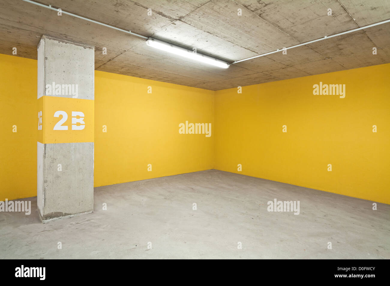 Empty underground parking lot area - Stock Image