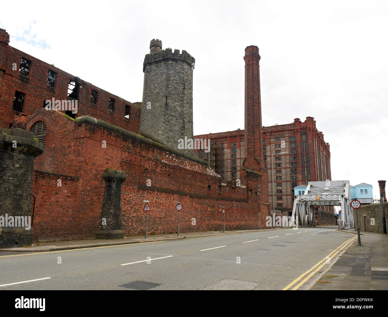 Bascule bridge with Tobacco warehouse and Stanley Dock on Dock Road in Liverpool UK Stock Photo