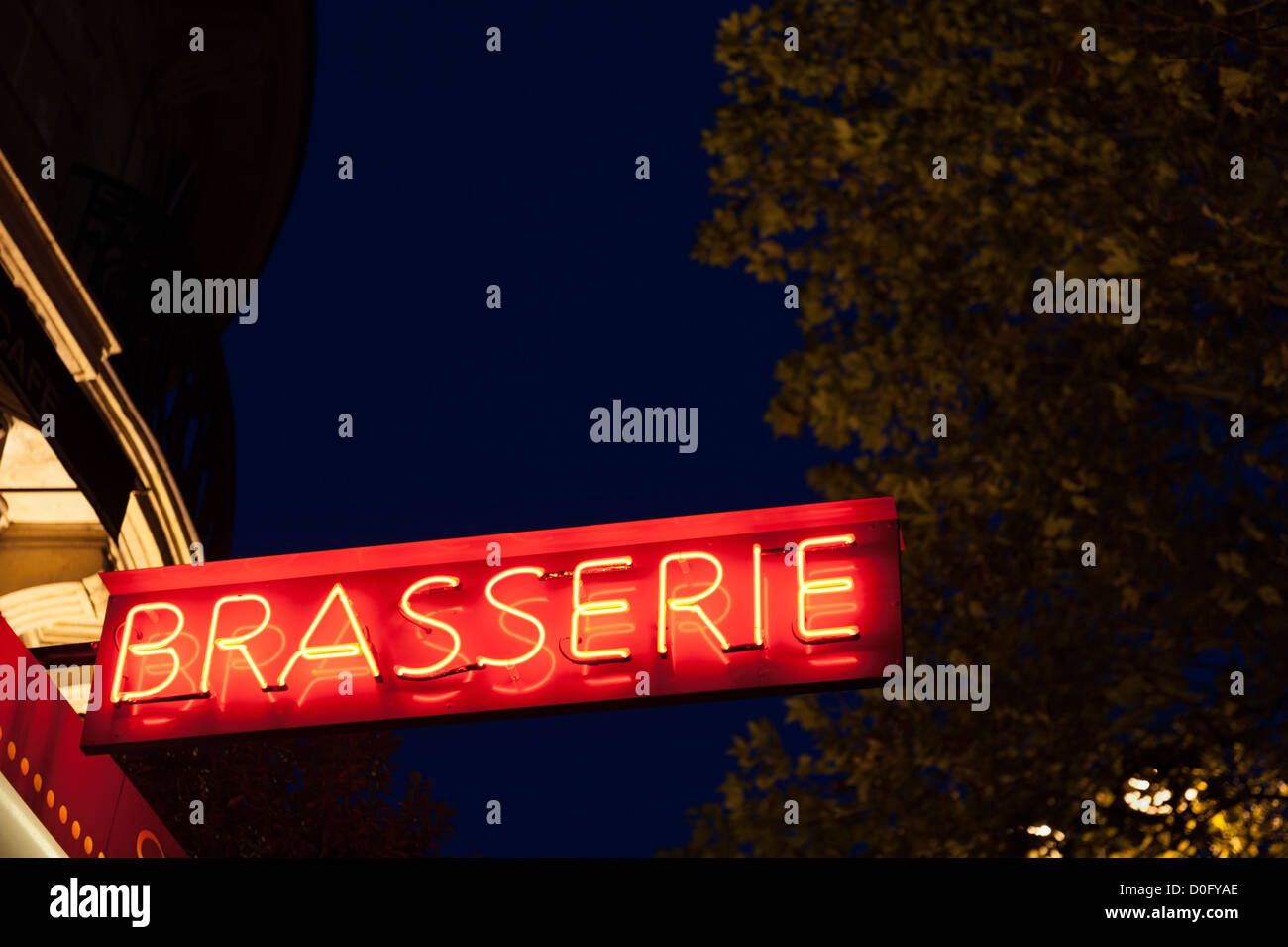 French brasserie sign at night - Paris, France - Stock Image