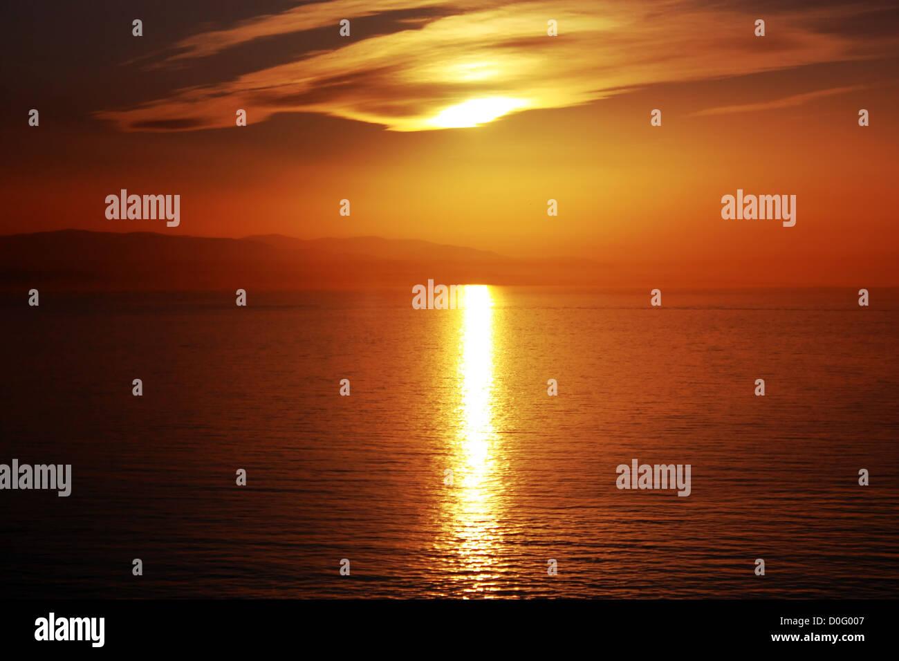 Seaside sunset scene in warm colors horizontal - Stock Image