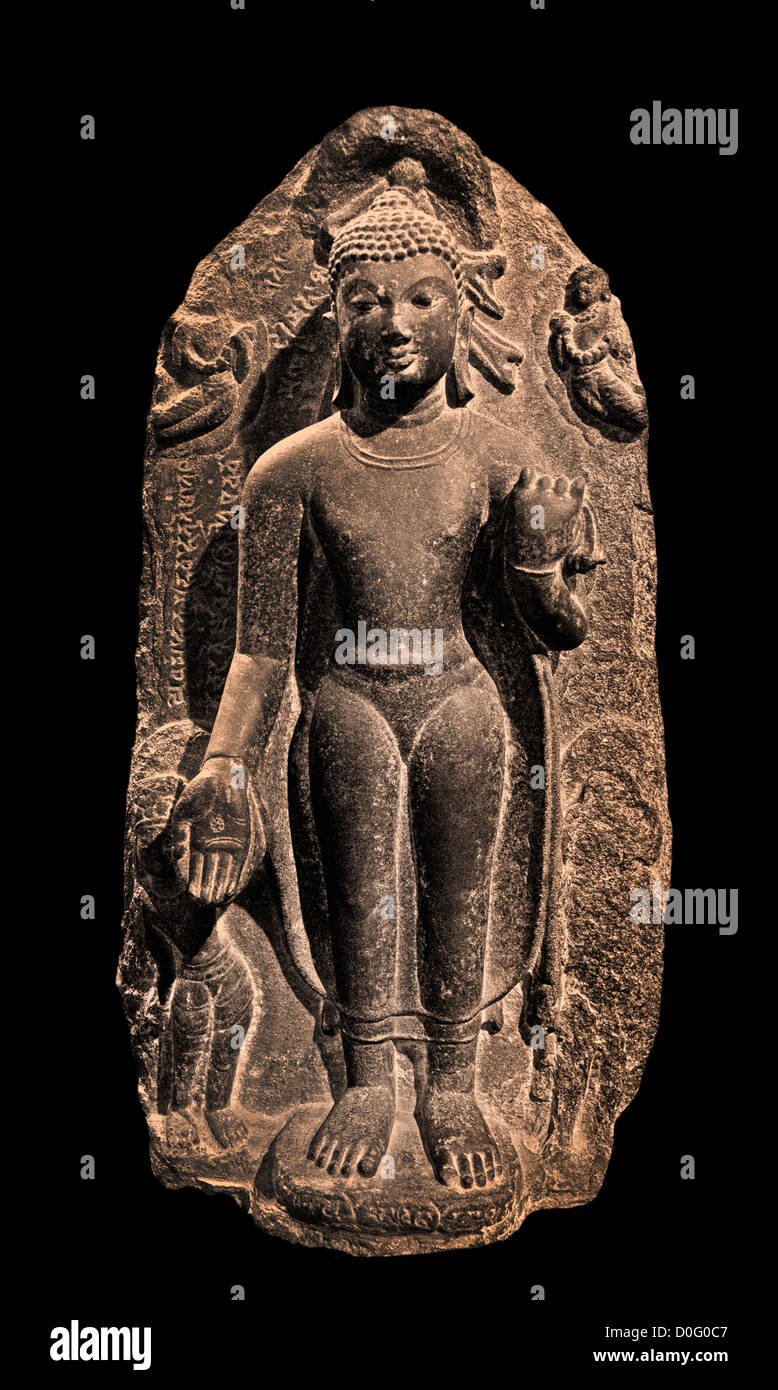 Standing Buddha in Varada Mudra with Attendants Indian ary Pala Style 9th Cent AD - Stock Image