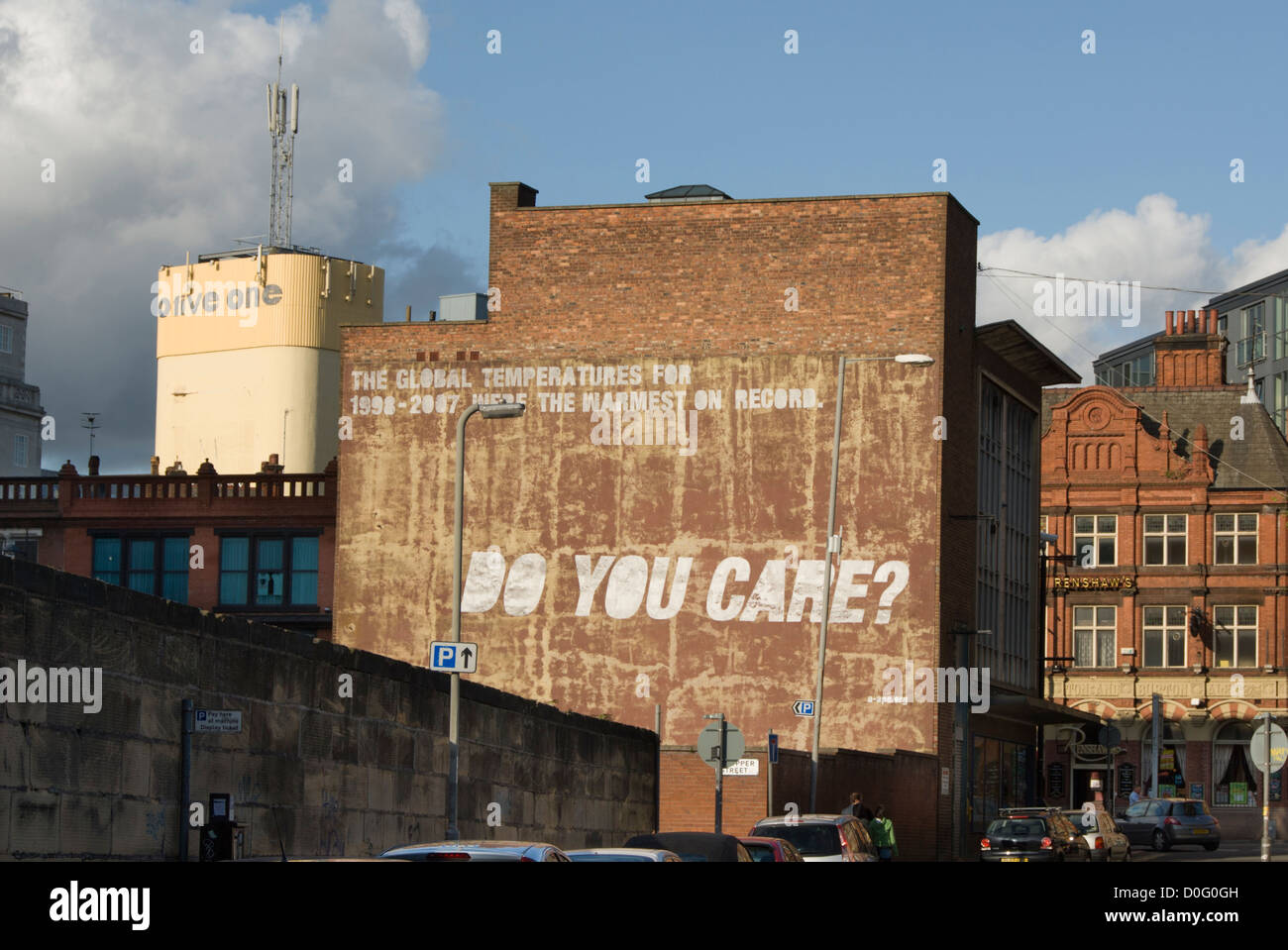 Slogan on wall about pollution, environment and global warming: Do you care? - Stock Image