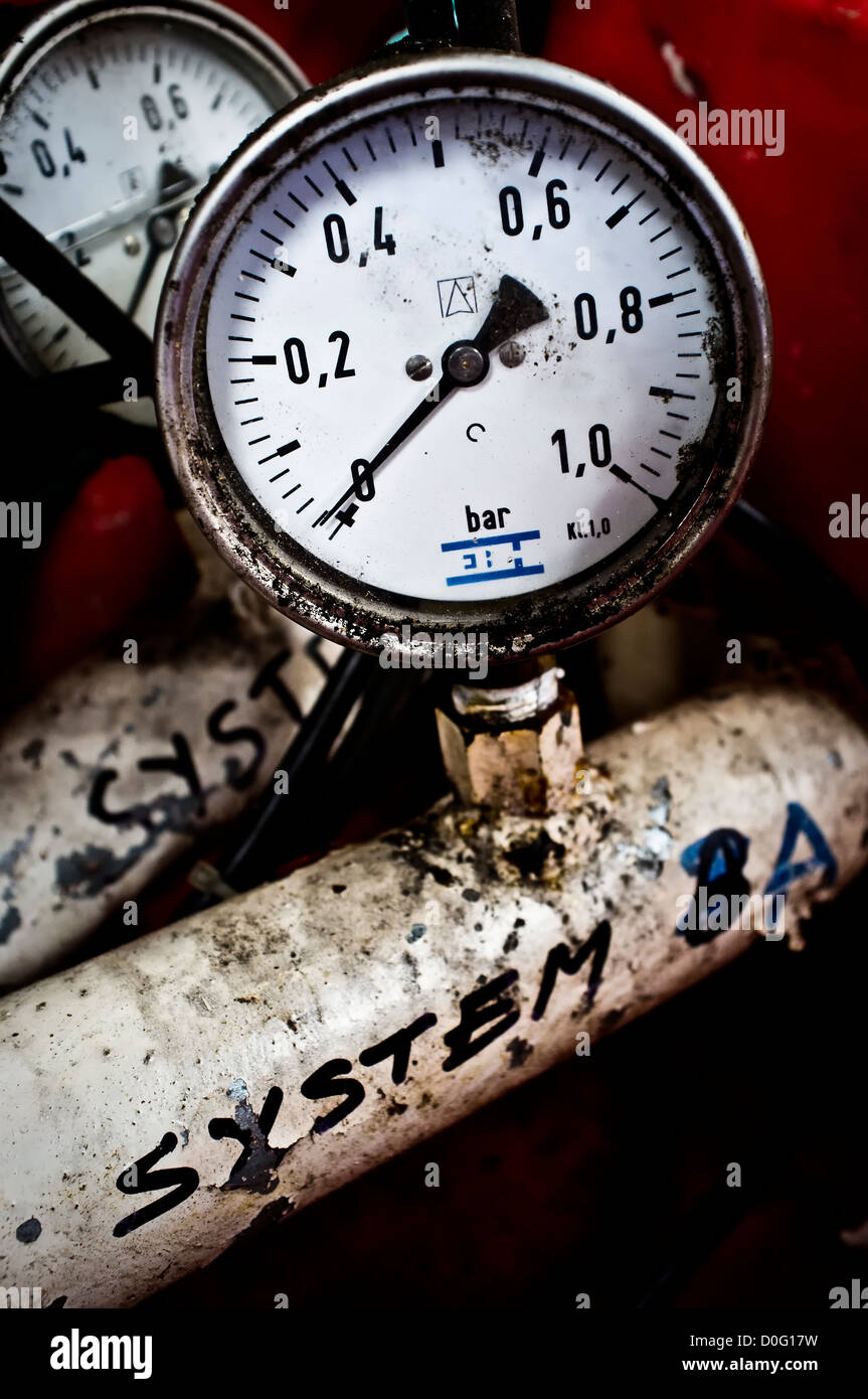 Pressure gauge from decommissioned fish farm feeding barge. Loch Duich, Scotland, UK - Stock Image
