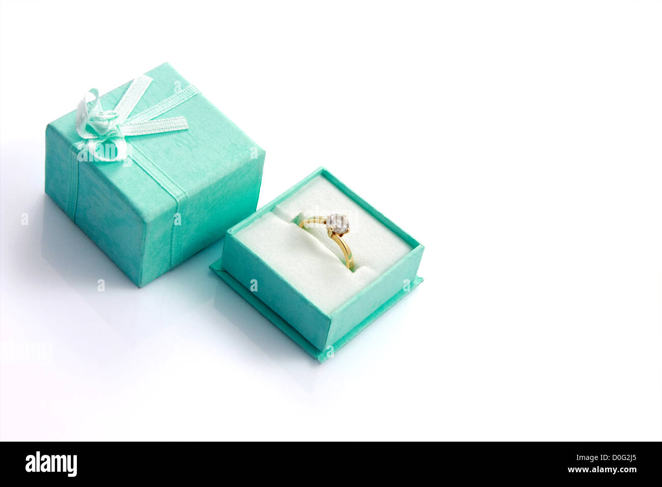 Diamond ring in green gift box isolated on white with copyspace - Stock Image