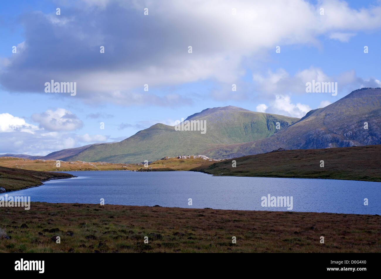 Beinn Spionnaidh and Cranstackie seen across Loch Tarbhaidh, by the A838 road on the North Coast 500 route, Sutherland, Stock Photo