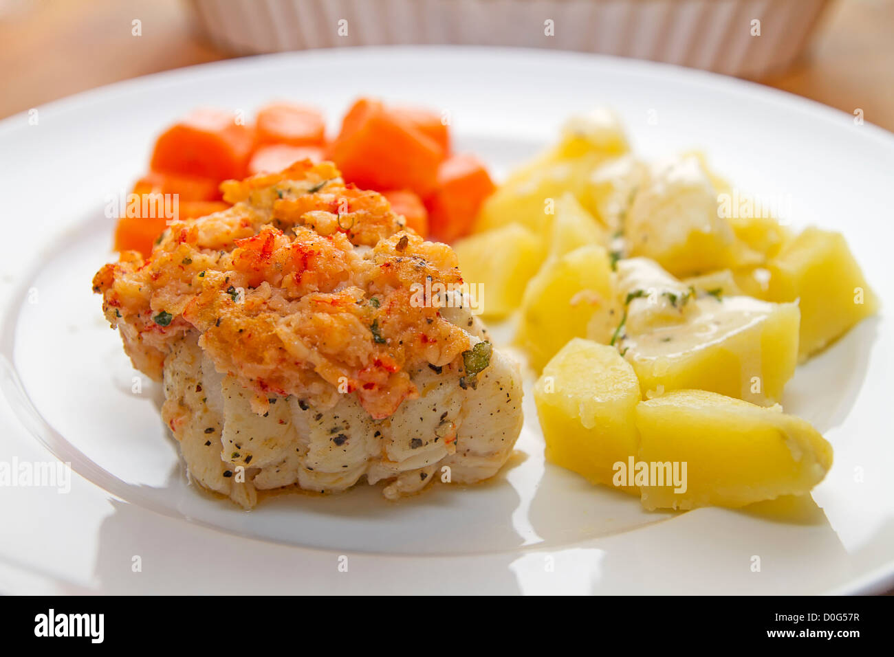 Monkfish with crayfish crust and vegetables - Stock Image