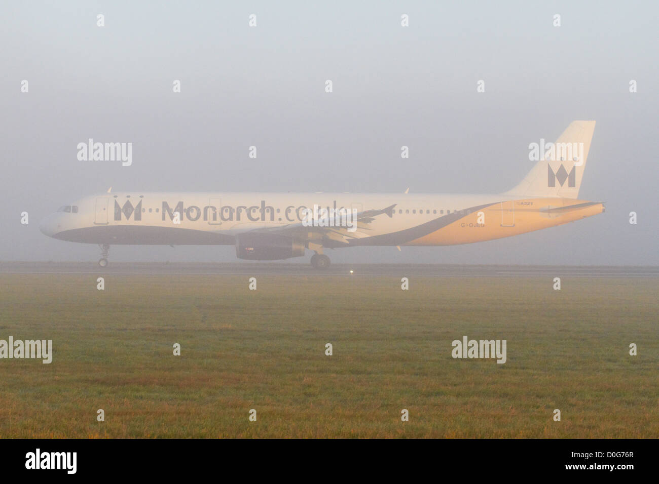 Monarch Airlines Airbus A321 taking off on a foggy morning Stock Photo