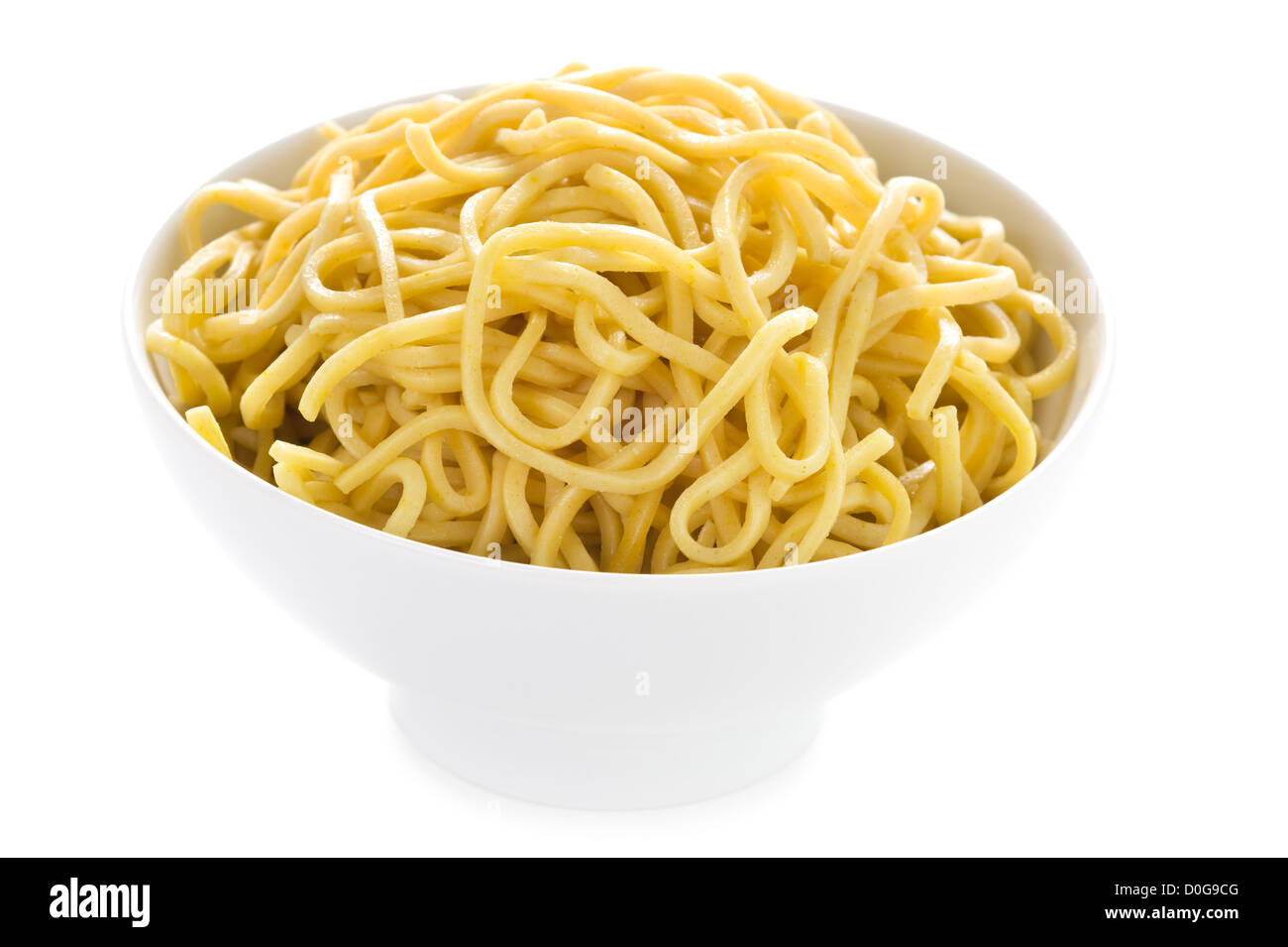 plain cooked egg noodles in a bowl - Stock Image