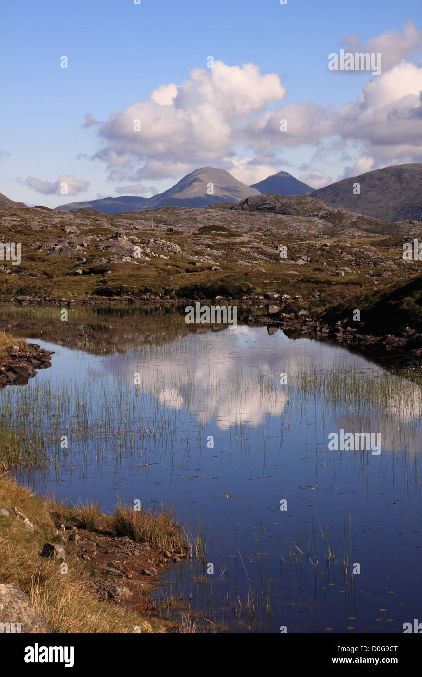 UK Scotland Western Isles Outer Hebrides Isle of Harris from a highland lochan and the Harris Mountains - Stock Image