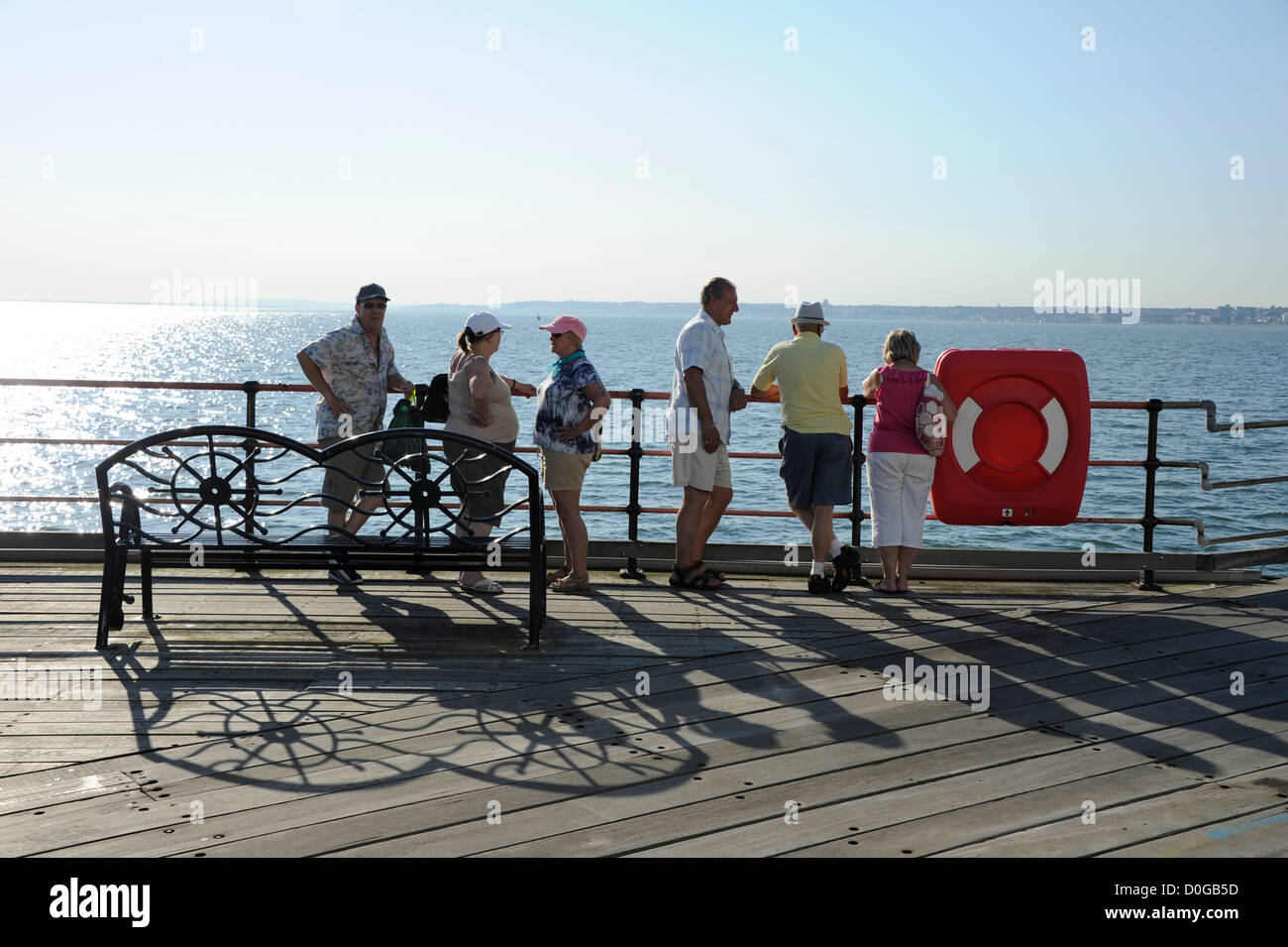 Holiday makers on the pier at Southend on Sea, Essex. At 1.34 miles long it is the longest pleasure pier in the - Stock Image