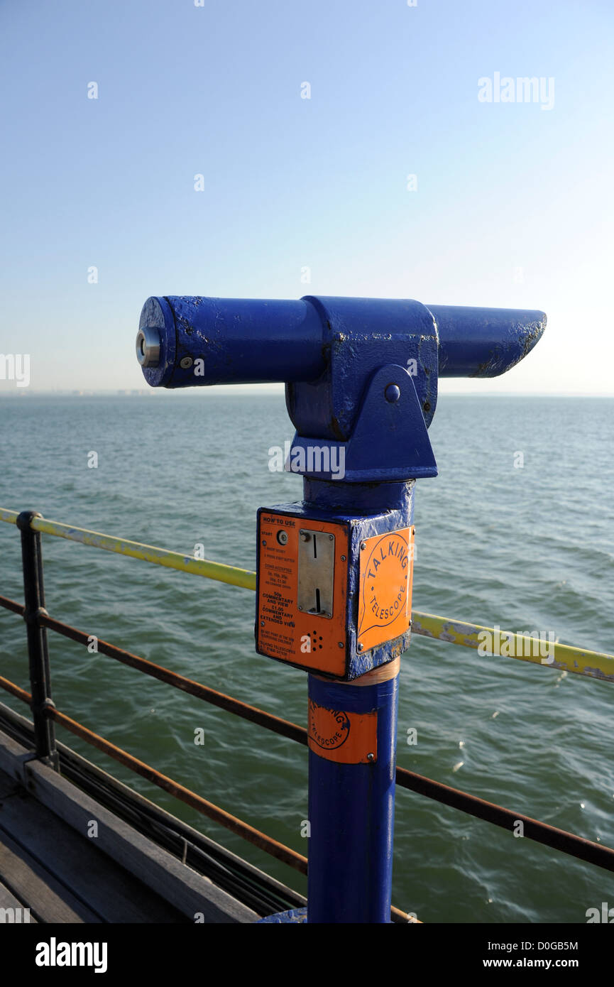 A telescope on the pier at Southend on Sea, Essex. At 1.34 miles long it is the longest pleasure pier in the world - Stock Image