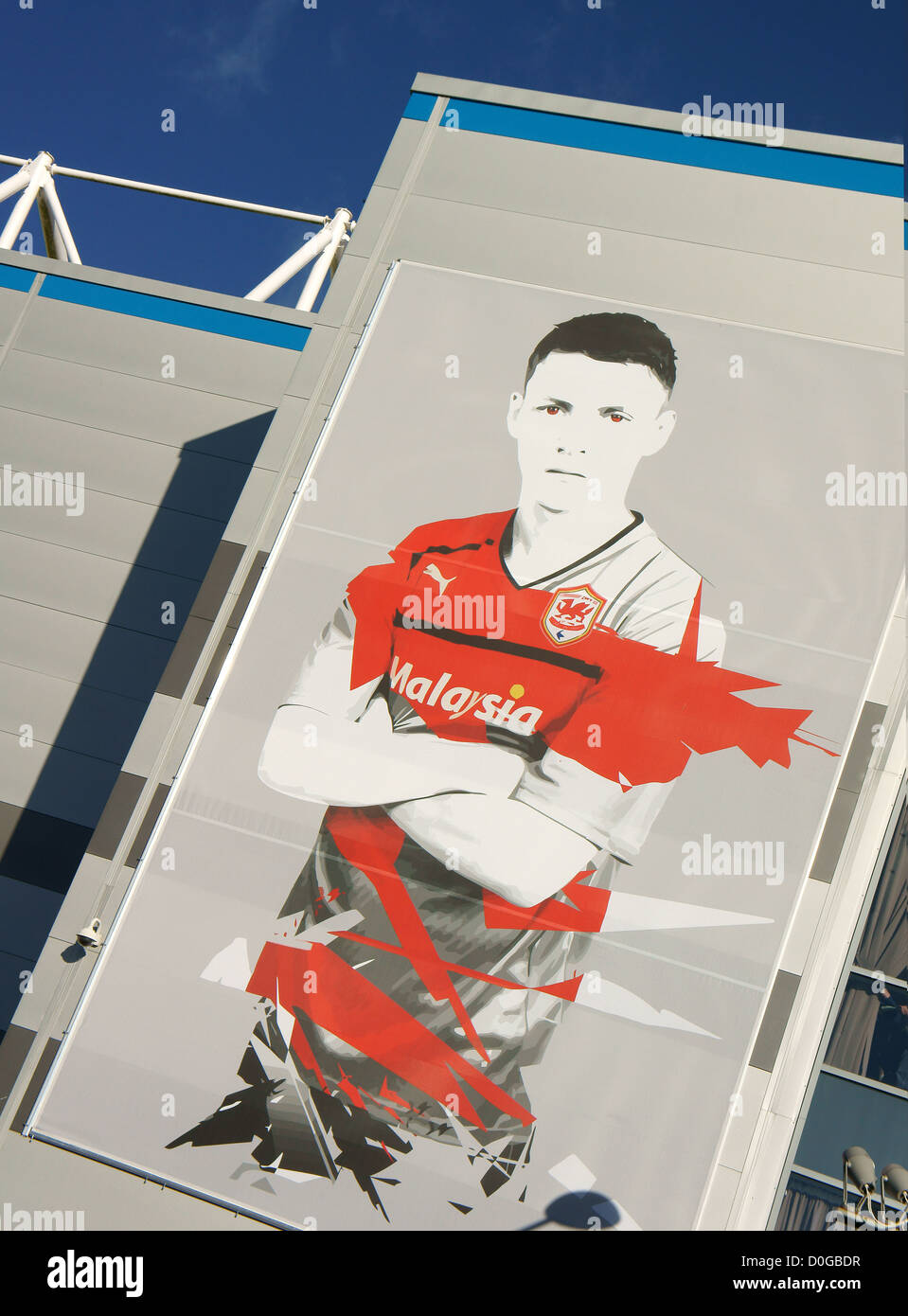 Image of a Cardiff City Footballer on the outside of the Cardiff City Stadium, Cardiff, South Wales, UK - Stock Image