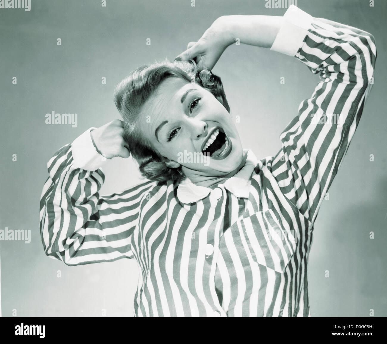 Black and white print of woman yawning - Stock Image
