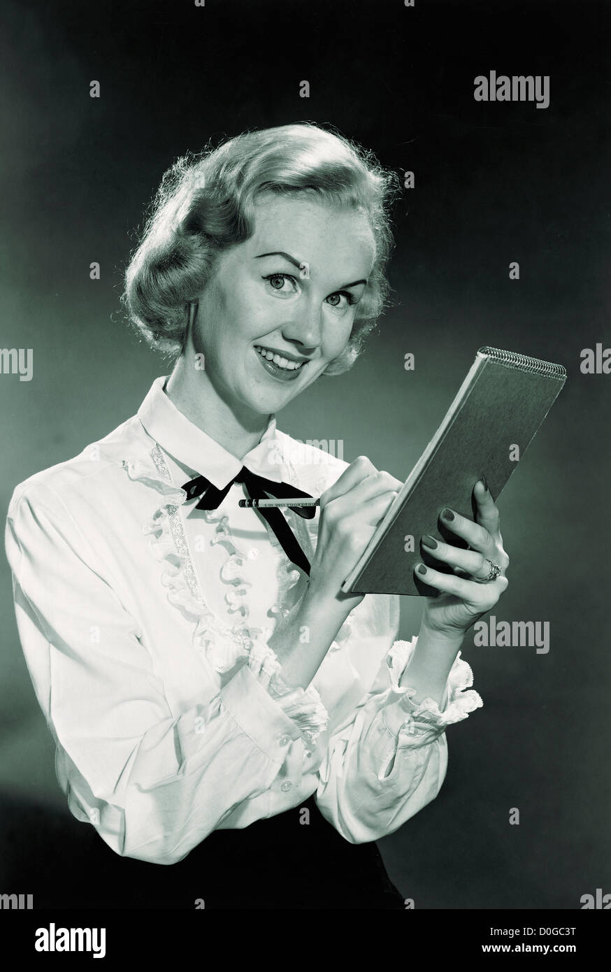 Black and white print of woman taking notes - Stock Image