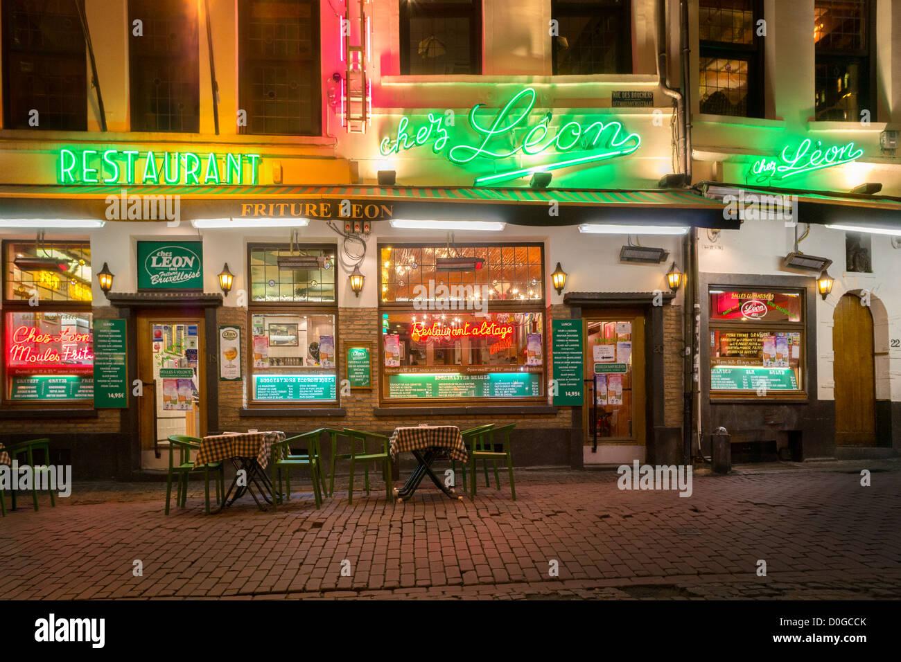 Famous Belgian mussels and chips restaurant Chez Léon, Leon, Rue des Bouchers Brussels. Traditional friture - Stock Image