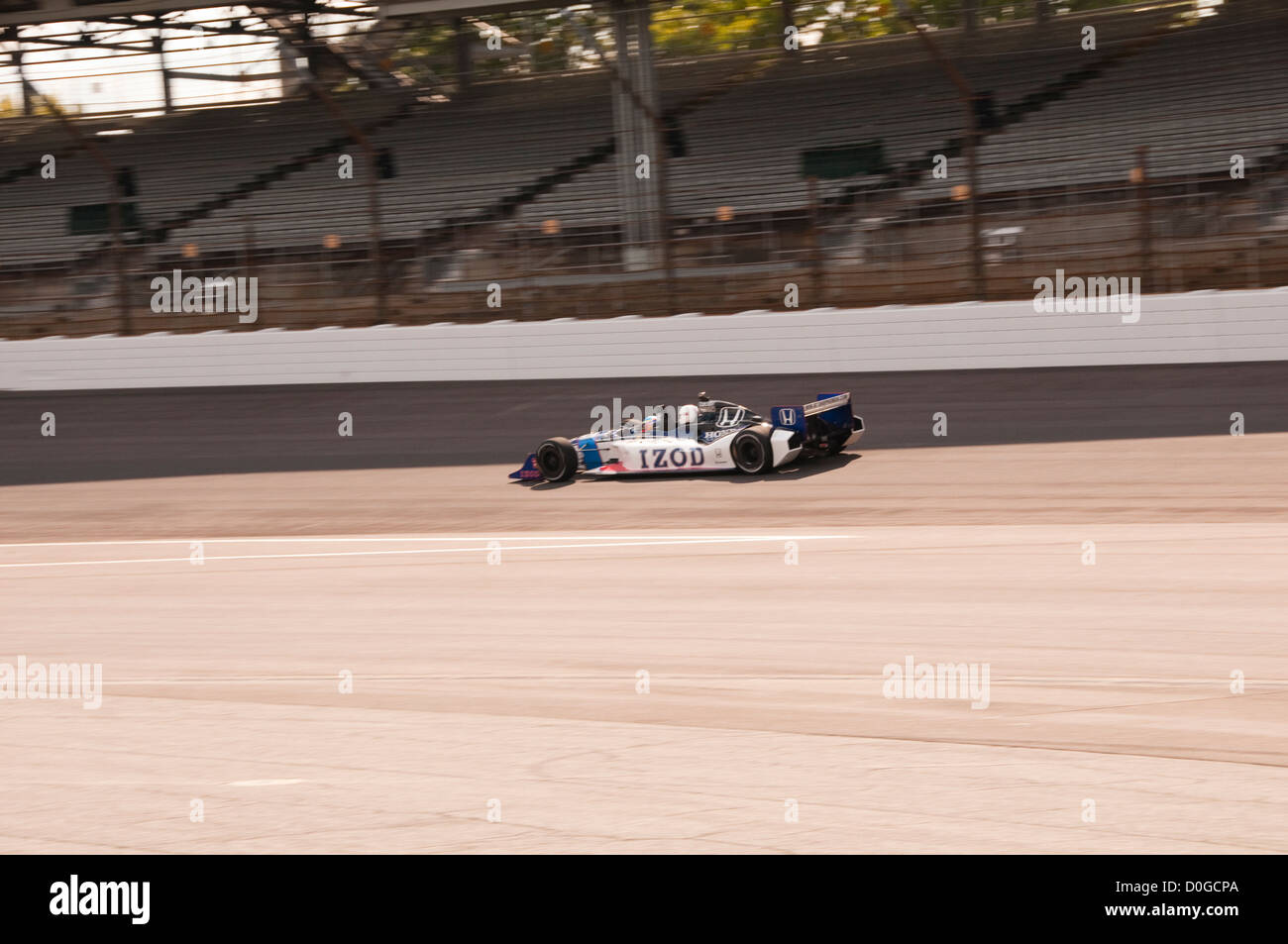 USA, Indiana, Indianapolis Motor Speedway, tourist riding back seat  Indy car around track with real Indy driver - Stock Image