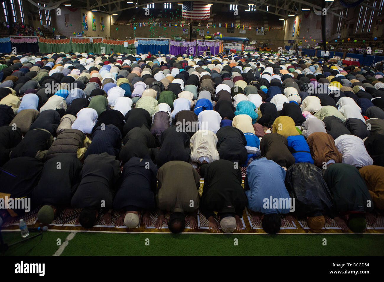 Muslim-American men pray at the annual Eid al-Adha prayer at the Teaneck Armory in Teaneck, New Jersey. - Stock Image