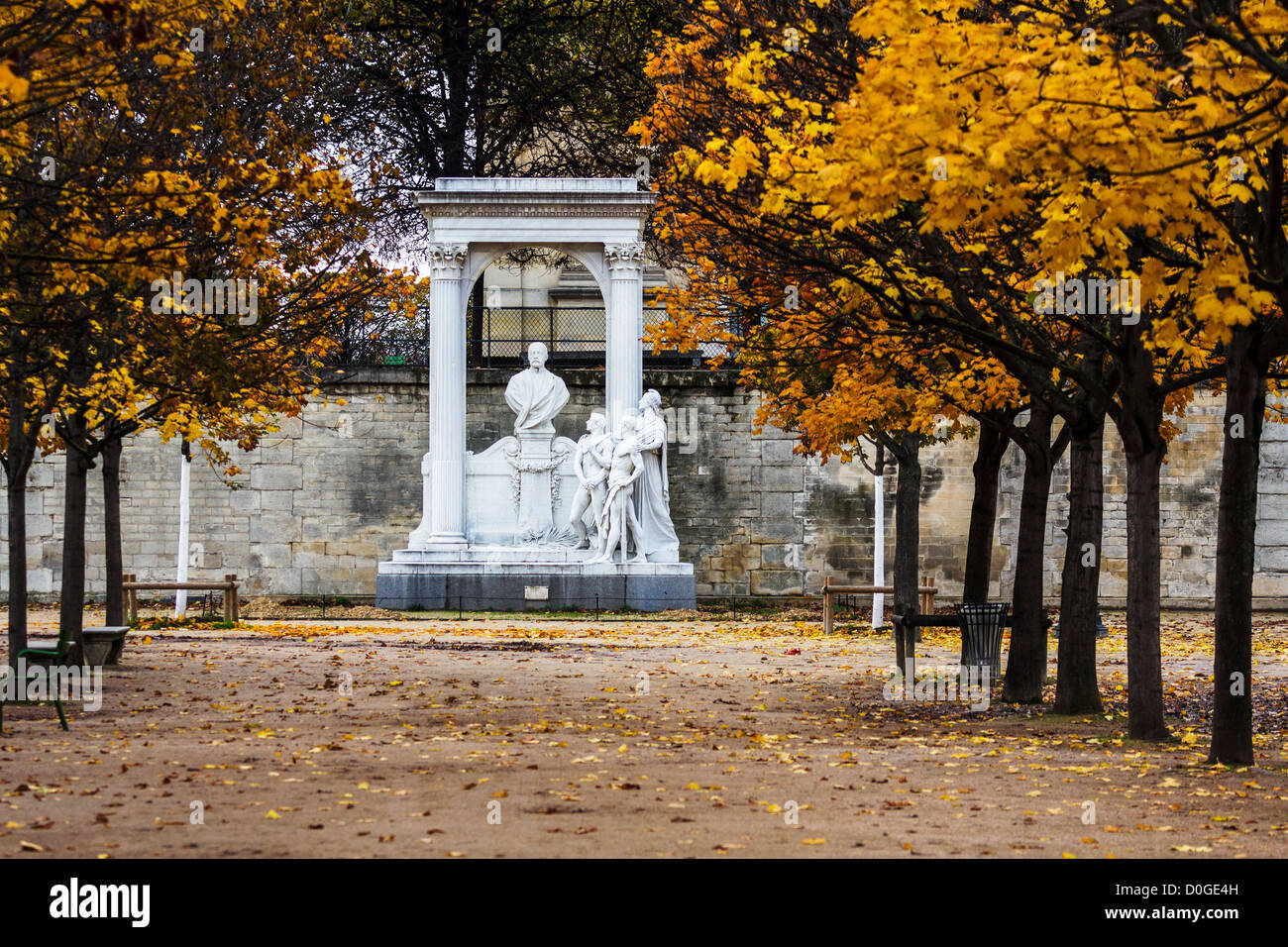 Jardin des Tuileries in Autumn with Waldeck Rousseau monument in background, Paris, France - Stock Image