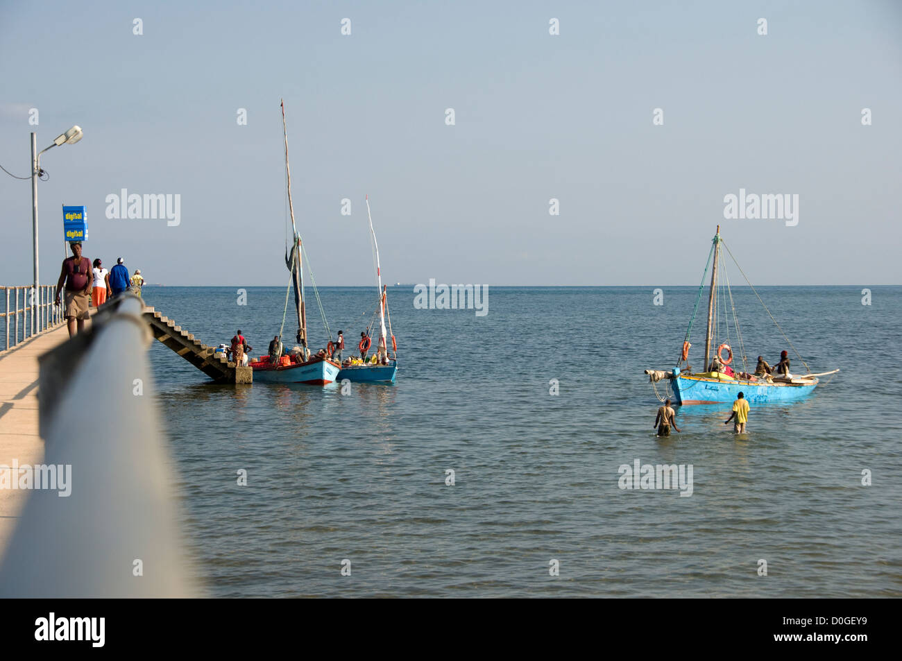 Inhaca jetty is bustling with activity as local traders come to fetch their merchandise which has arrived from Maputo. Stock Photo