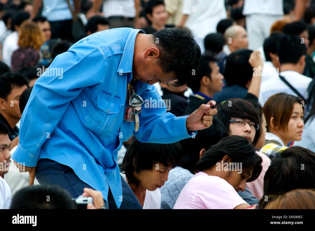 Thai Man in Trance, Wai Khru (Honour the Teacher) Tattoo Festival, Wat Bang Phra, Nakhon Pathom Province, Thailand - Stock Image
