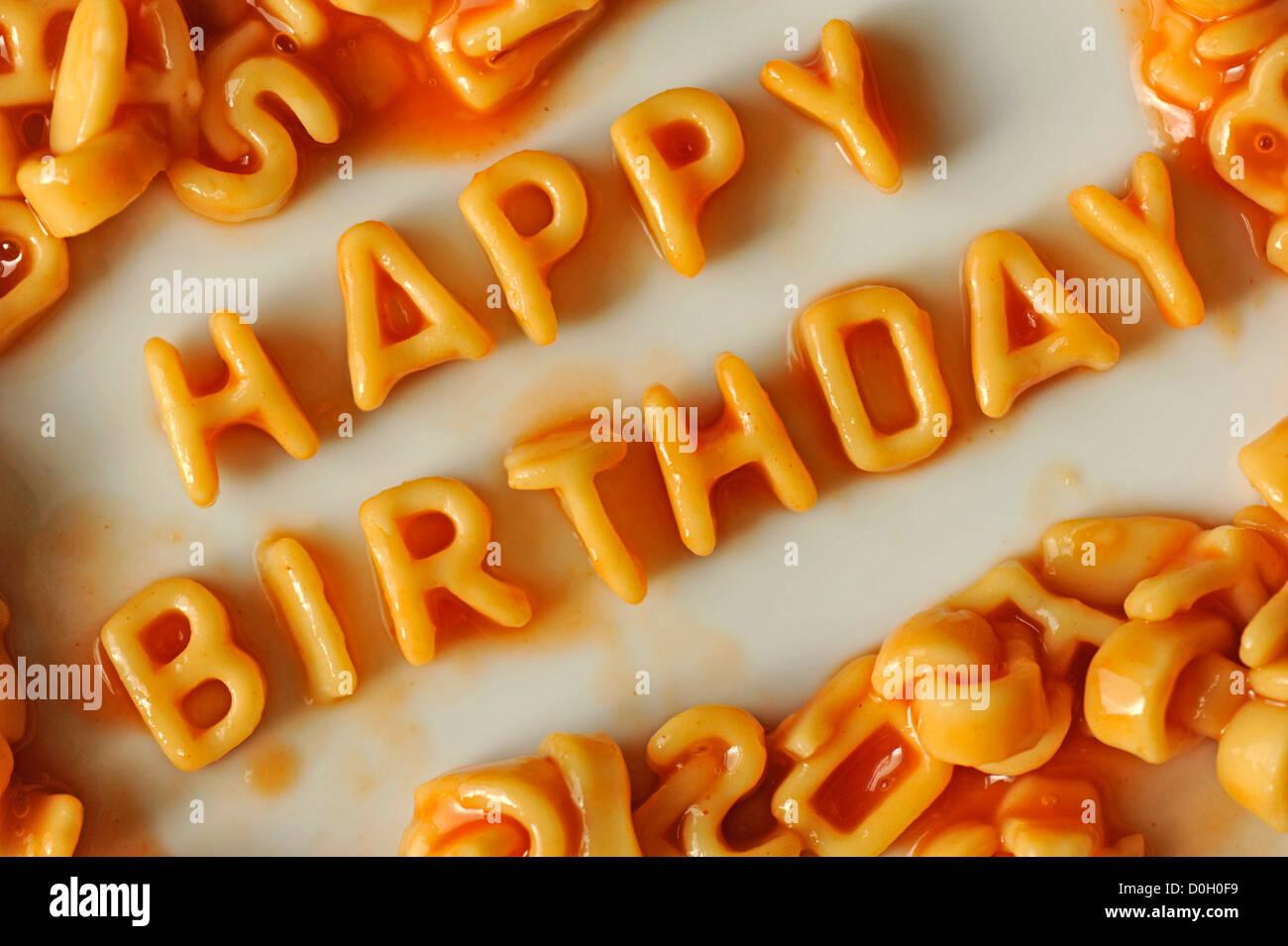 Alphabet Spaghetti Arranged To Spell Happy Birthday Stock Photo