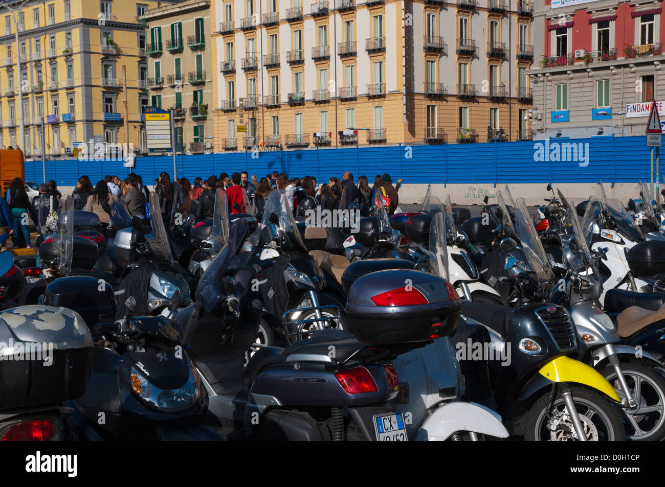 Scooters parked in front of central railway station Piazza Garibaldi square central Naples Italy - Stock Image