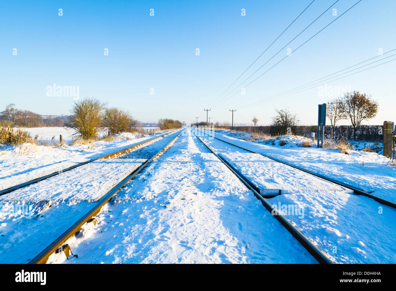 Winter snow on railway lines in the Nottinghamshire countryside, England, UK - Stock Image