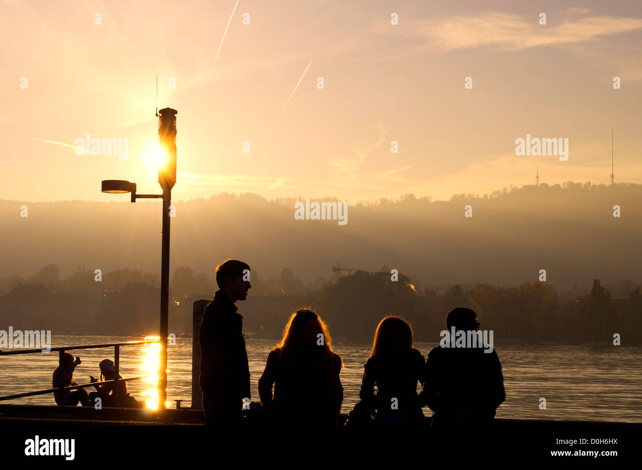 Sunset silhouette along the lake of Zürich in Switzerland - Stock Image