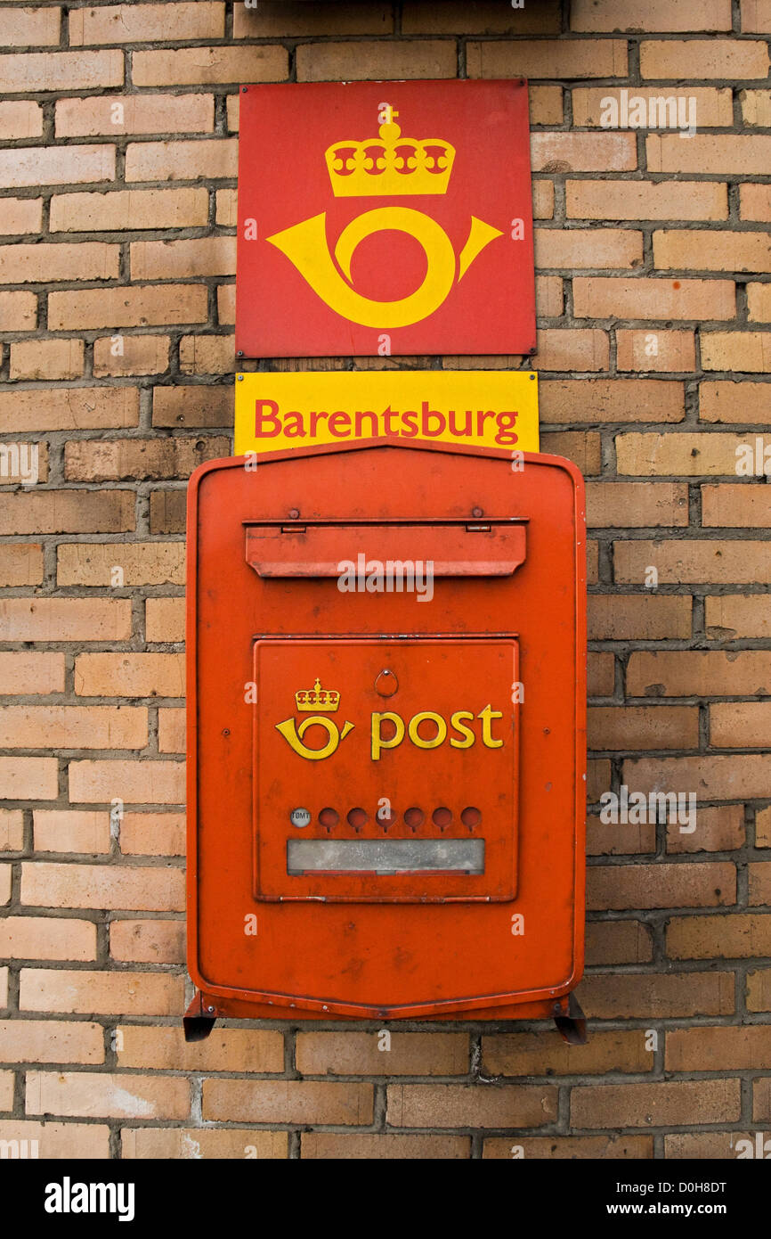 Colorful red and orange postal box in the Russian coal mining settlement of Barentsburg, Spitsbergen, in summertime. - Stock Image