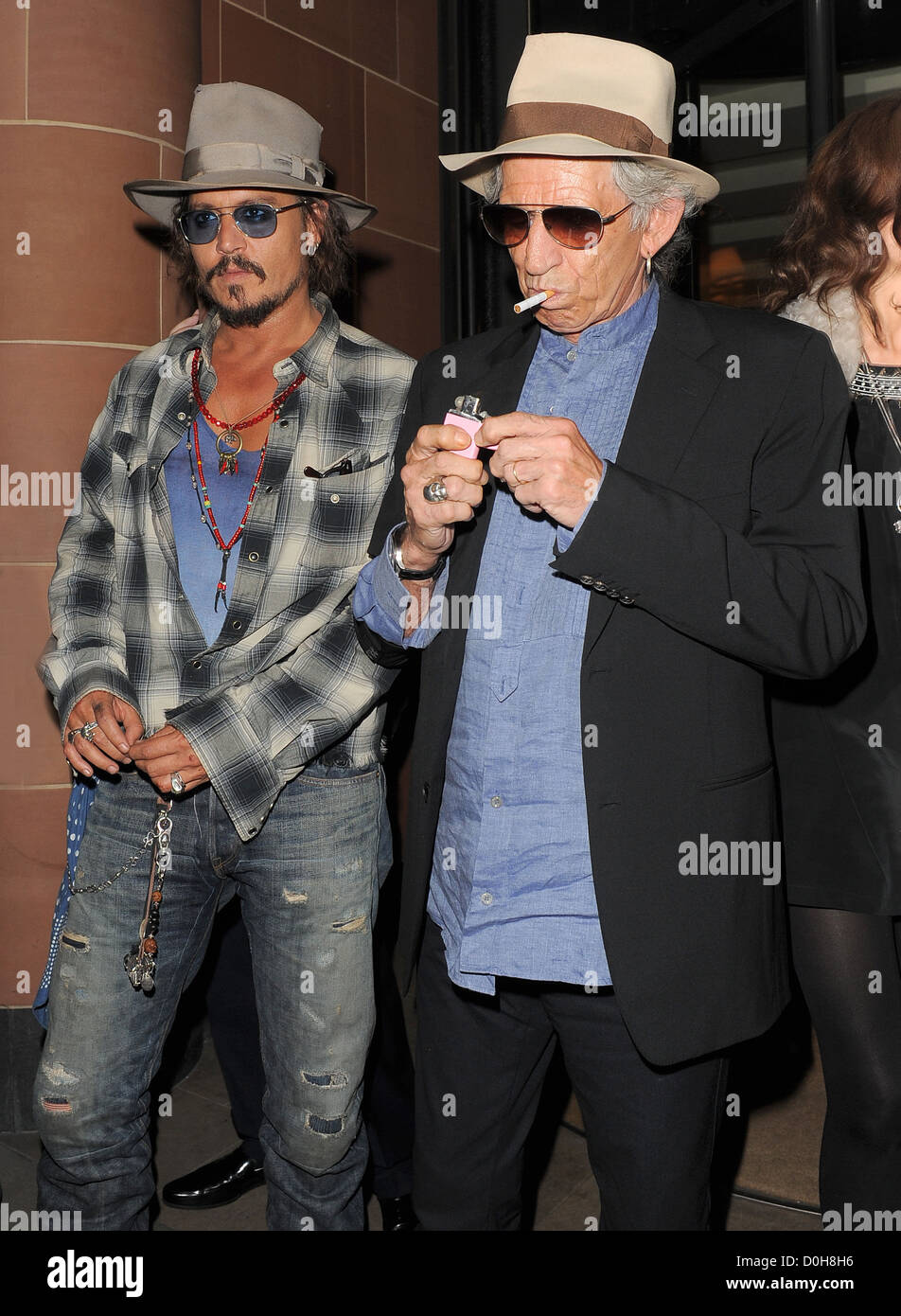 Johnny Depp and Keith Richards both wearing fedora hats and sunglasses 0ae79c0ae57