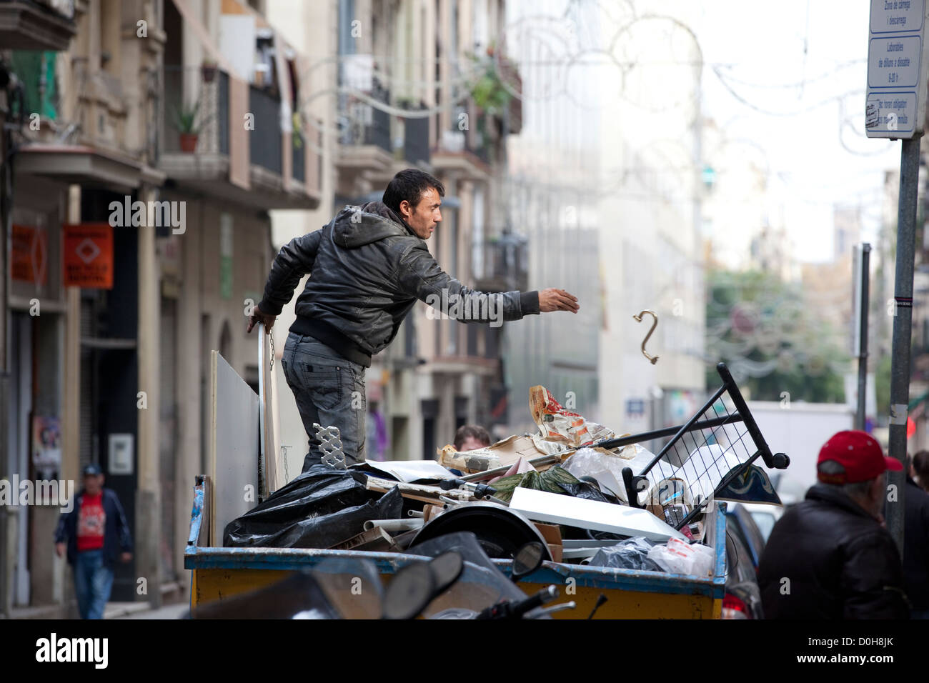 Romani people looting from skips in the streets of Barcelona, Catalonia, Spain, - Stock Image