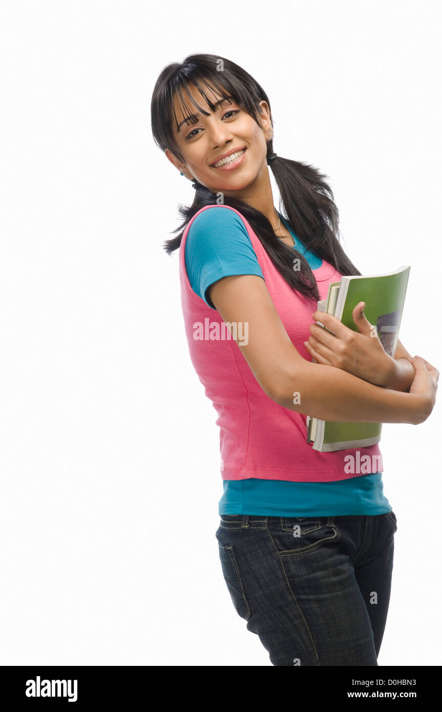 Portrait of a female college student with files - Stock Image