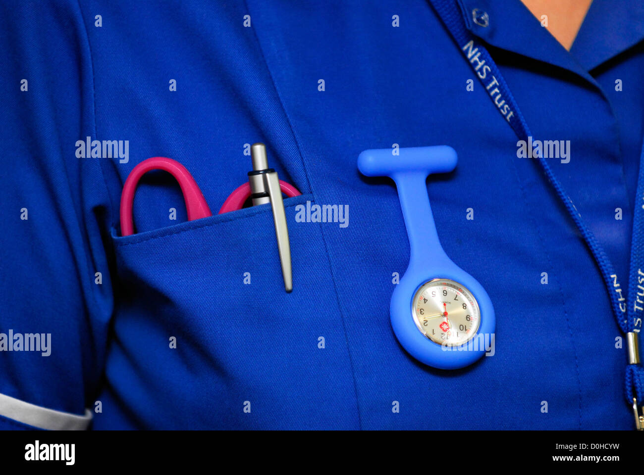 NHS Nurse in uniform at healthcare centre, UK. - Stock Image